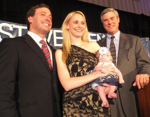HAPPINESS PREVAILS… It was a family/team victory (left) for Councilman and Democratic nominee for St. Louis County executive Steve Stenger (left) and Prosecuting Attorney Bob McCulloch (right) when the final tally came in showing both won landslide victories in Aug. 5 primary. Stenger is joined by his wife Ali (center) and their one-month-old daughter, Madeline Jane.