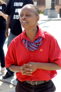 "'THIS IS MY JOB,' Rebekah Izeman, a fast-food worker at the McDonald's on Tucker Blvd. in St. Louis said. ""I would appreciate it if McDonald's stopped hiding behind their franchises and their logos and pay us for the services that we provide to them."""