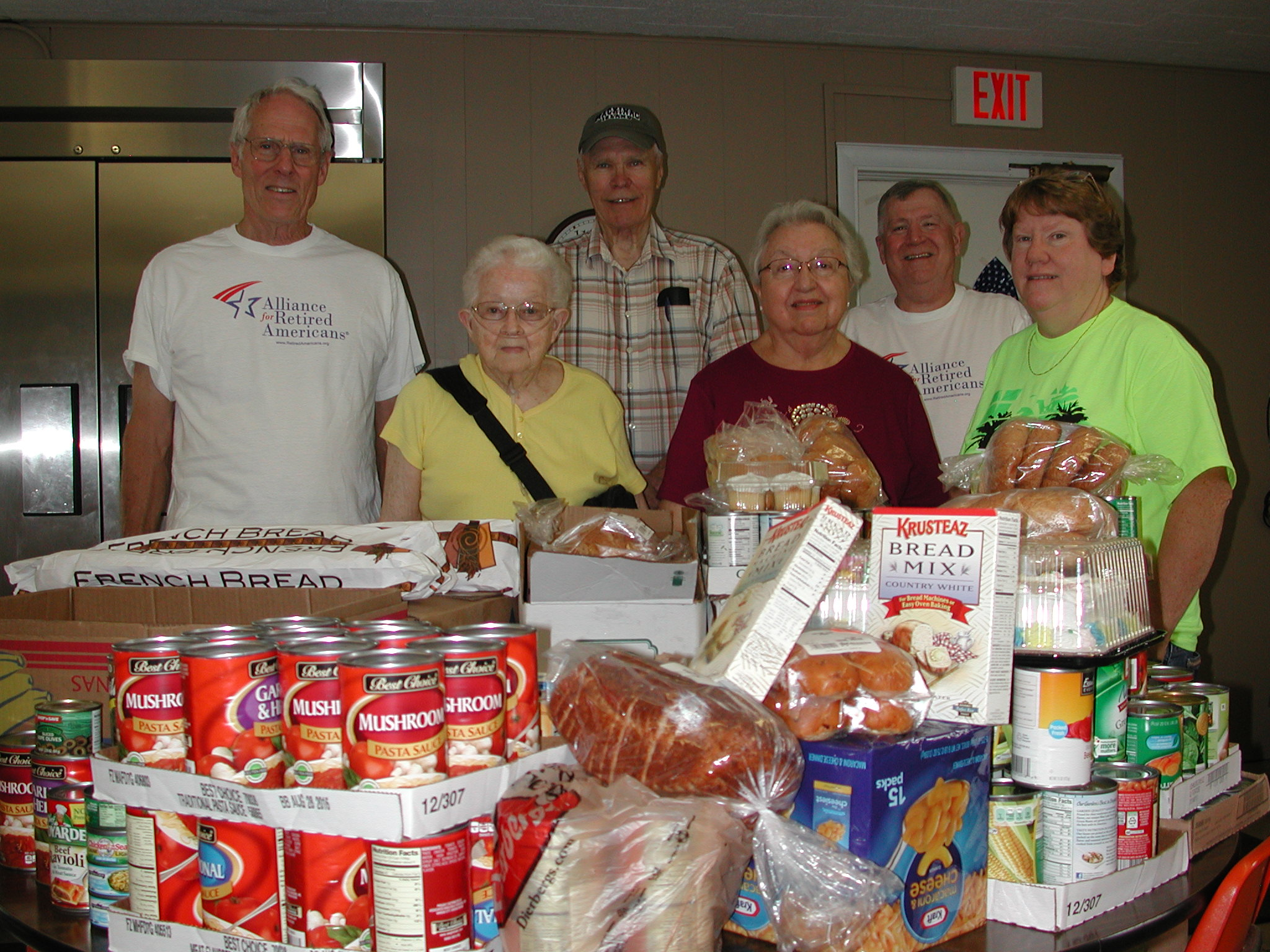 MAKING A SPECIAL DELIVERY to the Licking Bridge Builders Senior Center are (front row, from left) Licking area residents Viola Bailie and Betty Castor and senior center Board President Cynthia Wampner, and (back row, from left) Missouri Alliance for Retired Americans President Dave Meinell, senior center cook Bob Mitana and ARA volunteer and United Media Guild retiree Kevin Madden.  – Lillian Maxey photo