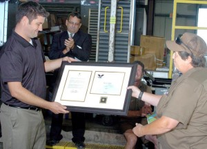 DELIVERING BASKETS OF HOPE: UPS supervisor Dave Wallis (left) presents the President's Volunteer Service Award to Teamsters Local 688 member and UPS employee Marilyn Hull. – Jill Bock/Sikeston Standard Democrat photo