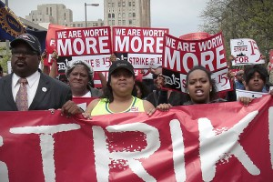 "WOMEN WORKERS AND LABOR activists march for a higher minimum wage for fast food workers in Detroit in May 2013. Veteran Feminists of America (VFA) will host a conference on ""Labor & the Women's Movement"" Sept. 27 in St. Louis. Reuters/Rebecca Cook photo"