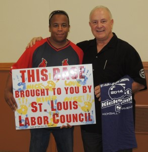 "ST-ELL PRESIDENT Gordon Smith, CWA Local 6300, presented St. Louis Labor Council President Bob Soutier with a t-shirt and a card ""signed"" with the handprints of some of the children served by the Crisis Nursery. The Labor Council was one of the sponsors of the event."