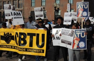 ON THE MARCH: Metro workers and supporting union members marched around Metro headquarters to send a message to CEO John Nations that his teams' race-baiting negotiating tactics were not acceptable and would not be forgotten. –Labor Tribune photo
