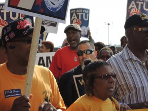 "STANDING TOGETHER: Mark Esters (center of photo in red shirt), vice president of the CBTU St. Louis Chapter and organizer for CWA Local 6355, told Metro workers ""ATU is not in this alone… We're going to be here a long time."" – Labor Tribune photo"