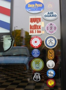 Union stickers adorn the window at Southtown Barbershop, where there's always a discount for union members. – Labor Tribune photo