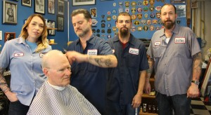 SOUTHTOWN BARBER SHOP prides itself in being union, represented by UFCW Local 655 since it opened 10 years ago. The union barbers are (from left) Megan Stewart, Tim Hopmeier, Bobby Benitez and owner Dave Devine. – Labor Tribune photo