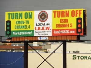 A NEW BILLBOARD posted by IBEW Local 4 announces a new contract with Channel 4, which was reached without destroying the union's jurisdiction as demanded by Channel 5. The Channel 5 boycott continues. The union reminds readers that Channels 2 and 11 are 100 percent union and also deserve viewership.  – Labor Tribune photo
