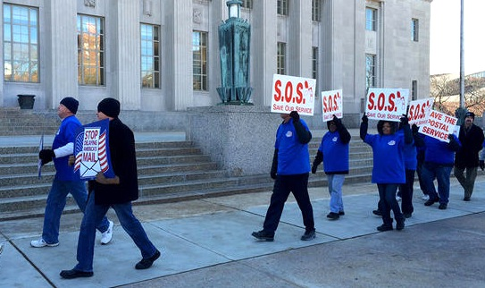 POSTAL WORKERS protesting proposed service cuts outside the Main Post Office in Downtown St. Louis on Nov. 14. – Camille Phillips/St. Louis Public Radio photo