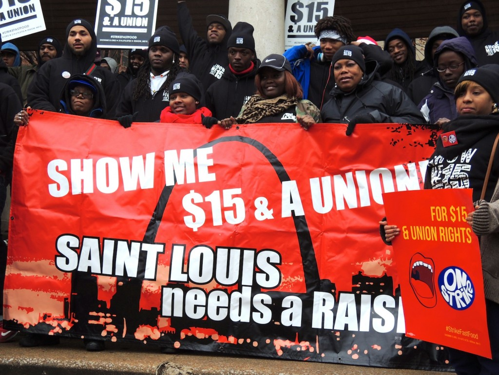 FAST FOOD WORKERS braved the cold and rain in downtown St. Louis Dec. 4 as part of a daylong series of marches and strikes here and nationwide to demand $15 an hour and the right to form a union. The movement is growing, with home care workers, convenience store cashiers, discount store clerks, airport workers and other low-wage workers joining in the call for a living wage and union rights. – Labor Tribune photo