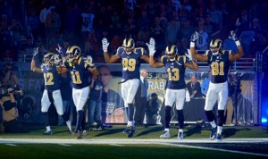 """""""WAY OUT OF BOUNDS"""" is the way the St. Louis Police Officers Association characterized five St. Louis Rams who entered the dome last Sunday displaying the """"hands up, don't shoot"""" gesture. Players from left to right: wide receivers Stedman Bailey and Tavon Austin, tight-end Jared Cook, and wide receivers Chris Givens and Kenny Britt.  – Jeff Curry/USA Today photo"""