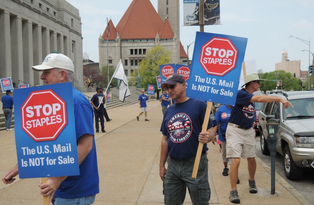 RETURN TO SENDER: Letter Carriers and Postal Workers rallied Sunday, April 27, outside the main post office in downtown St. Louis on April 27, 2014 to oppose USPS's move to outsource Postal Workers' jobs to Staples stores around the country. – Labor Tribune file photo