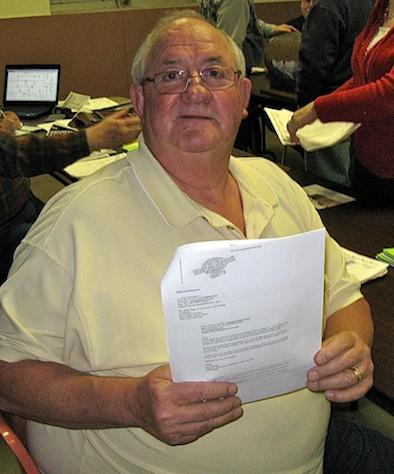 HARD EVIDENCE: Southwestern Illinois Central Labor Council President Bill Thurston shows a printout of the faked union bug. – Labor Tribune photo