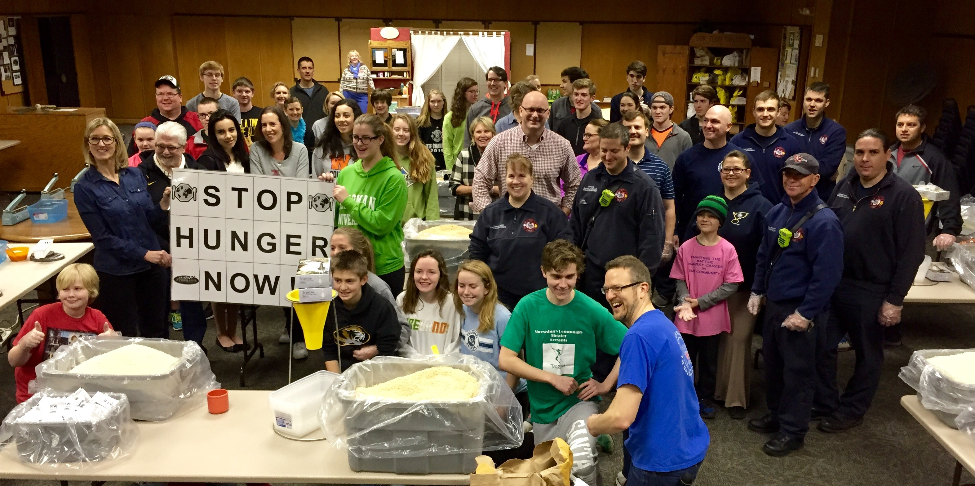 FEEDING THE HUNGRY: Fifteen members of IAFF Local 2665 with the Webster Groves Fire Department and their families teamed with the Webster Groves Presbyterian Church to prepare 20,000 meals for Stop Hunger Now.