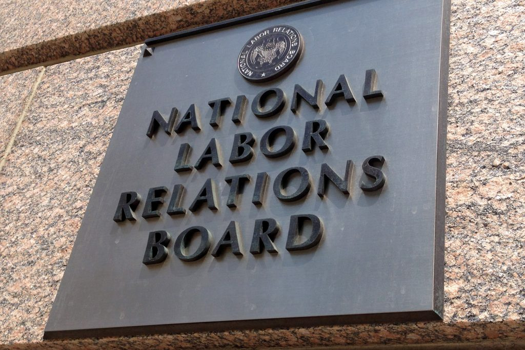 The sign for the National Labor Relations Board is seen on the building that houses their headquarters in downtown Washington, Wednesday, July 17, 2013. For such a tiny government agency, the NLRB has played an outsize role in the heated Senate filibuster fight over Obama administration nominations. But the board has long been at the center of a decades-long clash between labor unions looking to organize new members and business groups seeking to limit the role of unions in the workplace. (AP Photo/Jon Elswick)