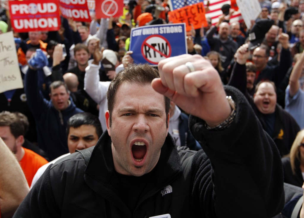Rob Parsons, a steelworker from Merrillville, Ind., screams during a union workers protest on the steps of the Statehouse after the Senate voted to pass the right-to-work bill in Indianapolis, Wednesday, Feb. 1, 2012. The governor is expected to sign the bill later in the day. (AP Photo/Michael Conroy)