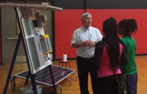 ENERGY FUTURE: Instructor Tim Kelley of the St. Louis IBEW/NECA Electrical Industry Training Center explains a solar array and its role in the future of energy technology to students at Jennings High School as part of Project Lead the Way. – Compass Communications photo