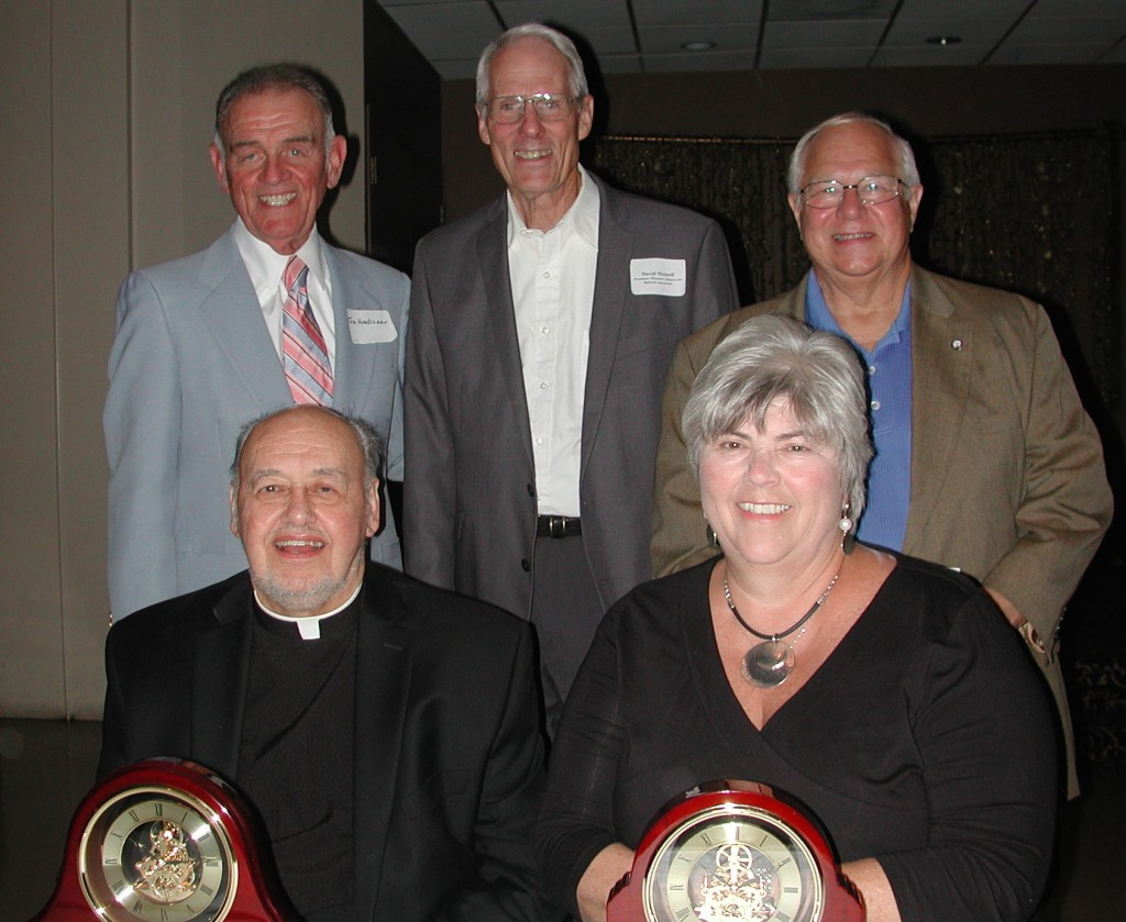 HONORED FOR THEIR WORK, Father Richard Creason (seated from left) received the Robert O. Kortkamp Humanitarian Award and State Sen. Gina Walsh (D-Bellefontaine Neighbors) received the Missouri Legislator of the Year Award. Presenting the awards were (standing from left) Tom Hadican, Missouri Alliance for Retired Americans President Dave Meinell and IBEW Local 1 President and former state legislator Tom George. – Kevin Madden photo
