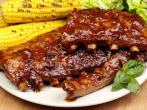 A rack of scculent pork ribs qith sweetcorn