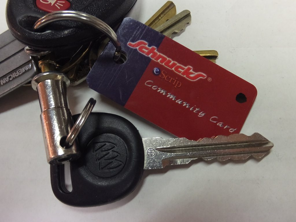 A HANDY KEYCHAIN eScrip card comes with the regular business card sized eScrip card whey you sign up.