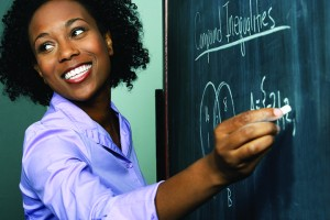 Teacher Writing Equation at Blackboard