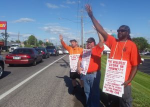 HONKING CARS showing their support for Teamsters 688 handbilling at Schnucks Market. Local 688 members wave back in appreciation.