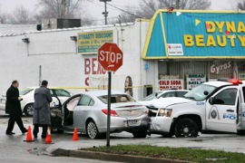INVESTIGATORS at the scene of a police chase, crash and a fatal shooting of Anthony Lamar Smith by St. Louis police officer Jason Stockley near the intersection of Goodfellow Boulevard and West Florissant Avenue in 2011. –Post Dispatch photo by Erik Lunsford