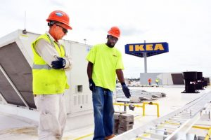 SOLAR ENERGY BENEFIT: Pat Wittich and Daniel Adkinson of Aschinger Electric place rails around solar panels on the roof of the new IKEA located in the St. Louis' Cortex Innovation District. – Wiley Price/St. Louis American photo