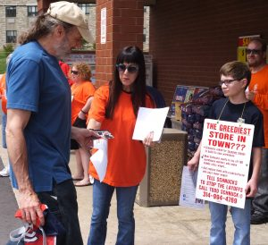 "JIMMY HOFFA'S GRANDDAUGHTER, Barbara Dengel, along with her 12-year old son JR, joined Teamsters Local 688 members catching shoppers coming and going at the Schnuck Market in Kirkwood. She found everyone ""very receptive"" to our story because Schnucks is ""just plain wrong"" in firing 190 workers. – Labor Tribune photo"