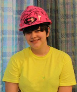"SUPERGIRL: Grayce Barkley was delighted with the pink ""Supergirl"" hardhat signed by more than 45 tradeswomen working on the BJC project. – Labor Tribune photo"