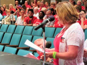 POOR PAY: Gretchen Moser, vice president of the Lindbergh National Education Association, challenged board members at their June 15 meeting to put Lindbergh teacher salaries in the top five of the area's benchmark districts. – Labor Tribune photo