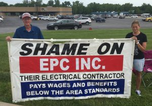 SPREADING THE WORD: Local 1 electricians Tom Crotty (left) and Shawn Benefiel recently passed out fliers at EPC's national headquarter in St. Charles the St. Charles location of EPC's alerting the public that the company is using a non-AFL-CIO affiliated, Local 57 electrical contractor at its new location in Wright City, Mo. – IBEW Local 1 photo