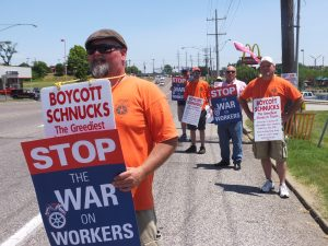 OUT IN FORCE, Teamsters Local 688 members promoting the Schnucks boycott June 18 in Overland were (from left to right) 20-year Schnuck employee John Trueblood, Vice President Chris Tongay, 20-year Schnuck employee Bob Christmann, Business Representative Mike Schlueter and 29-year employee Todd Varady. - Labor Tribune photo