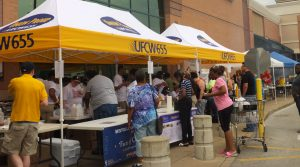 LAST YEAR'S BBQ, with lots of customers, and broad community and union support, helped the union raise $15,000 for Sickle Cell research, making Local 655 the single largest local raising monies for the UFCW's national Sickle Cell charity efforts. – Labor Tribune photo
