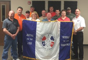 Local Lodge 313 President Rick Seaton (at far left) and District 9 Business Representative/Organizer Roy Collins joined new Machinists members for a group photo.