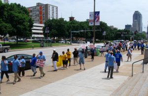 CARRYING THE MESSAGE: Postal workers found public support as they marched along Market Street.
