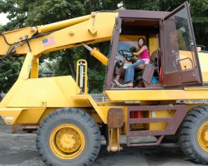 Girl in Earth Mover