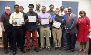 PROUD GRADUATES of the recent Building Union Diversity class and their instructors are (front row, from left) BUD graduates Austin Head, Jalon Holmes, Cedric Shields and Jeremy Steamer, plus Michael Holmes, executive director of SLATE, and Vicki Edwards, MSD director of human resources. In back (from left) are BUD instructor Jim Duane of STLCC, MSD Executive Director Brian Hoelscher, graduates Bernard West and Malik Benton, Charles Williams of SLATE and Pat Dolan of the Missouri AFL-CIO and Sprinkler Fitters Local 268. Graduate Shanika Harris was absent.