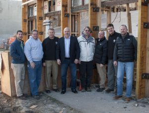 BEHIND THE SCENES: Key members of the renovation project take a photo break in front of museum as work was in progress. From left: Greg Murdick, Sachs Electric project manager; Dale Roth, Local 1 superintendent; Dave Roth, Local 1 business representative; Frank Jacobs, Local 1 business manager; Marc Bacchetti, structural engineer; Jamie Henderson, Henderson and Associates Architects; John Kahrhoff, Local 1 business representative; and Matt Kahrhoff, museum video producer. – IBEW Local 1 photo