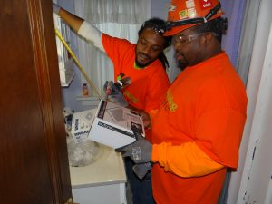 REBUILDING TOGETHER: IBEW Local 1 apprentices Princeton White (left) and Anthony Norwood prepare to install a vent in a home bathroom as part of this year's Rebuilding Together St. Louis project. Since 2003, the Electrical Connection has donated more than $800,000 in labor and materials toward efforts to improve more than 450 homes for low-income, disabled and elderly St. Louisans. – IBEW Local 1 photo