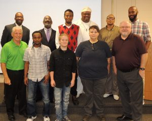 PROUD GRATUATES: The most recent class of BUD (Building Union Diversity) graduates were honored for their hard work before having an opportunity to meet with union representatives and contractors in a ceremony last week at the AGC Construction Training School in St. Louis. Pictured are (front row, from left) BUD Labor Liaison, Missouri AFL-CIO Apprentice Coordinator and St. Louis County Councilman Pat Dolan (President Sprinklerfitters Local 268) with Sied Hassan, Gabi Cranston, Amy Generally and BUD Project Manager Jim Duane of St. Louis Community College. In the back row are (from left) SLATE BUD Coordinate Charles Williams and SLATE Executive Director Michael Holmes with Eric Green. John Pope, Willie Griffen and Antoine Jones. – Labor Tribune photo