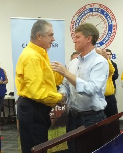 UFCW International President Marc Perrone (at left) tells Attorney General Chris Koster that his election as governor is critical to ALL working families. - Labor Tribune photo