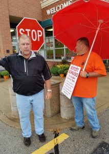 NOW IN FRONT OF SCHNUCKS STORES in at shopping centers where Schnucks does not own the entire center property, Teamsters Local 688 Executive Secretary-Treasurer Mike Goebel (left) and warehouse Chief Steward Darren Adkins at the Cottleville store. - Teamsters 688 photo