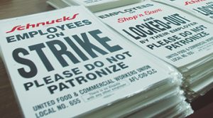 "READY IF NEEDED, UFCW Local 655 has ""strike"" and ""locked out"" signs ready but hopes not to have to use them unless Schnucks refuses to offer a fair contract."