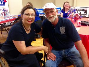 TAMMY DUCKWORTH visits with Rick Dustman, a Laborers Local 397 member and delegate to the Greater Madison County Federation of Labor. – Labor Tribune photo