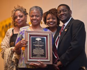 Organization for Black Struggle President Emeritus Jamala Rogers (second from left) receives her award from (at left) Organization for Black Struggle member and organizer with CWA 6355 Holly Roe, and (from right) St. Louis CBTU Chapter President Ozier and Organization for Black Struggle member Nikia Paulette. – Tiffany Esters photo